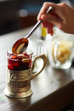 Mulled Wine Stirred With A Spoon In A Glass