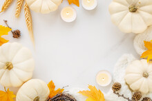 Hello Autumn Or Happy Thanksgiving Banner Frame With Phite Pumpkins And Orange Fall Leaves On A White Marble Background With Plenty Of Copyspace For Seasonal Greetings