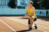 One young sportive man, male athlete, runner practicing alone before race at public stadium, sport court or running track, outdoors. Professional sport games.