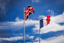 British Union Jack And French Flags With Sky