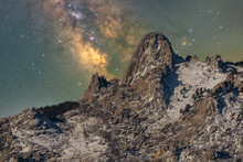 Snowy Mountains Under Starry Sky With Milky Way