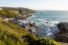 View From Above Of A Jagged Rocky Coastline, Cliffs And Path To The Beach And The Sea.