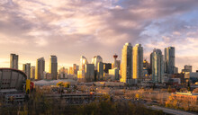 Calgary Cityscape Lit Up At Dawn.