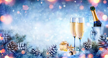 Christmas Celebration With Champagne - Flutes On Snow With Fir Branch And Bokeh
