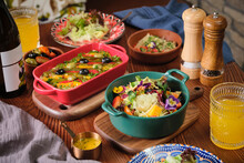 Beautiful And Tasty Mediteranean And Russian Salads On The Table Of Spanish Restaurant