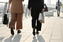 Horizontal Back View Shot Of Unrecognizable Women Wearing Elegant Formal Clothes Strolling Down Street Somewhere In Modern City