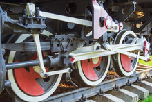 Wheels Of An Old Steam Locomotive. The Mechanism Of Train Movement. Old Train On The Tracks