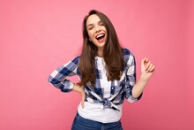 Photo Portrait Of Young Beautiful Smiling Hipster Brunette Woman In Trendy Blue And White Shirt. Sexy Carefree Female Person Posing Isolated Near Pink Wall With Empty Space In Studio. Positive Model