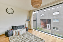 Modern Room Interior With Cushions On Carpet At Home