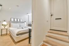 Stairs Against Bedroom Interior In Modern Hotel