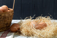 Fresh Chicken Eggs In A Basket On A Wooden Background