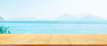 Wood Plank With Blue Sea And Mountains Background