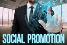 Text Caption Presenting Social Promotion. Internet Concept Advancing Students To The Next Grade To Be With Their Peers Man In Office Uniform Standing Pressing Virtual Button Holding Tablet.