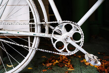 Fragment Of A White Bicycle In Retro Style. Painted Frame And Pedals For Outdoor Installation. Close-up