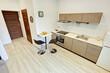 Beżowy pokój z kuchnią - kawalerka