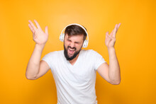 Dancing - Bearded Man With Headphones On His Ears.