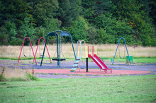 Empty Playground Derelict Swings And Slide In Rural Area