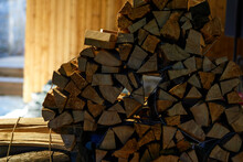 Close-up Of Birch Firewood In Wooden Pile Inside Barn