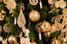 Christmas Tree With Gold Decorations Close-up