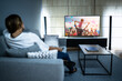 canvas print picture - Woman Watching TV Movie. Enjoying Cinema