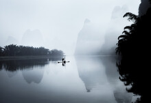 Fog On The Lijiang River With A Boat