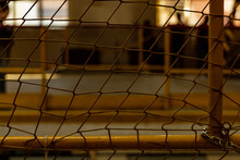 Yellow Net In Front Of Big Hall With Metal Yellow Railings