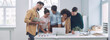 canvas print picture - Group of confident young people in smart casual wear discussing business while having meeting in office