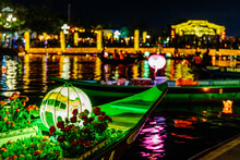 Festive Lights On Tourist Boats In River