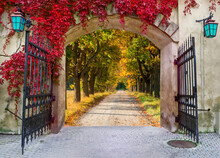Medieval Gate To Autumnal Countryside Road