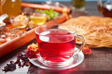 Cup Of Herbal Red Tea With Dry Roses Hibiscus