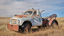 Old Rusty Towing Truck On A Prairie, Early Spring Scenery In Colorado