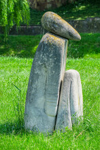 Stone Sculpture In The Park And Green Grass