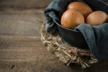 Raw Eggs In Egg Box On Rustic Wooden Background