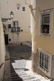 Fototapeta Uliczki - View of one of the narrow streets of the Alfama district, Lisbon.
