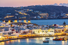 Chora Port Of Mykonos Island With Famous Windmills, Ships And Yachts During Colorful Sunset. Aegean Sea, Greece