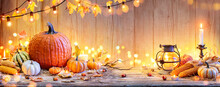 Pumpkins On Wooden Table - Thanksgiving Background With Vegetables And Bokeh Lights