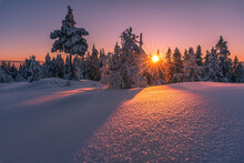 Beautiful Winter Sunset With Sunstar At The Mountain