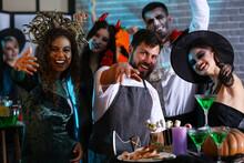 People Having Fun At Halloween Party
