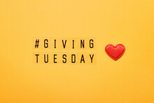 Giving Tuesday Text Message. Global Day Of Charitable Giving After Black Friday Shopping Day. Red Heart On Yellow Background