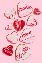 Studio Shot Of Heart Shaped Cookies Flat Laid Against Pink Background