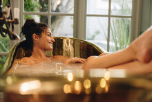 Happy Young Woman Enjoying A Relaxing Bath