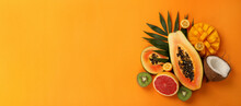 Exotic Fruits Set On Orange Background, Space For Text