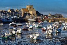 Port At Low Tide At The End Of The Sunny Day And Church Of Saint-Nicolas Of Barfleur, A Commune In The Peninsula Of Cotentin In The Manche Departmentin Lower Normandy In North-western France