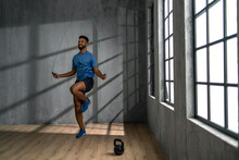 Young African American Sportsman Using Jumping Rope Indoors, Workout Training Concept.