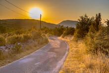 Sunrise Over Road In Causse Blandas