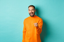 Cheeky Attractive Man Congrats You, Praising Good Job, Winking And Pointing At Camera, Standing Over Light Blue Background