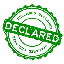 Grunge Green Declared Word Round Rubber Seal Stamp On White Background