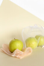 Apples In Reusable Eco Friendly Transparent Bags On Bright Background With Copy Space.