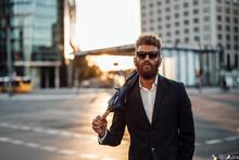 Businessman Wearing Sunglasses Carrying Umbrella On Shoulder