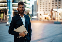 Smiling Male Freelance Worker With Beard Holding Digital Tablet